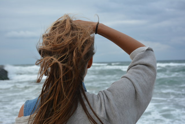 Back view hair observing ocean outdoors