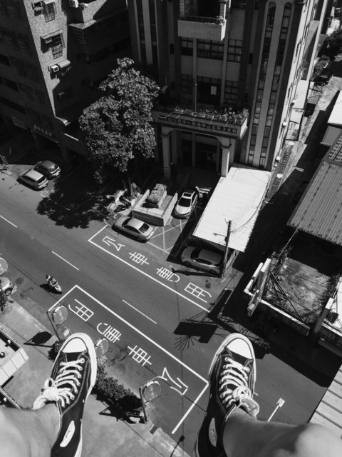 Black and white building cars feet footwear