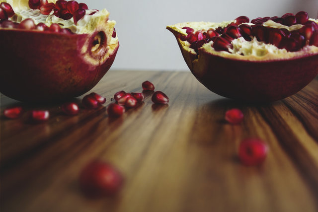 Food fruit pomegranate table wood