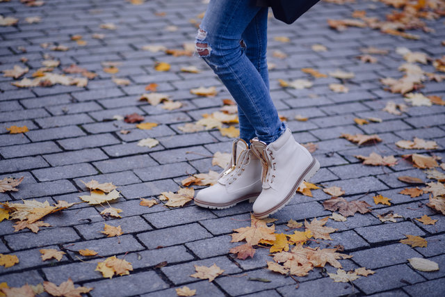 Autumn leaves brick cement cobblestone concrete