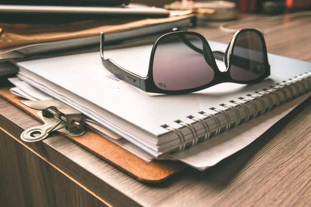 Clipboard desk eyewear notebook papers