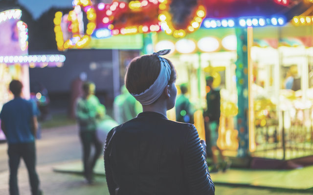 Back view blur carnival depth of field female