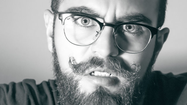 Adult beard black and white boy close up