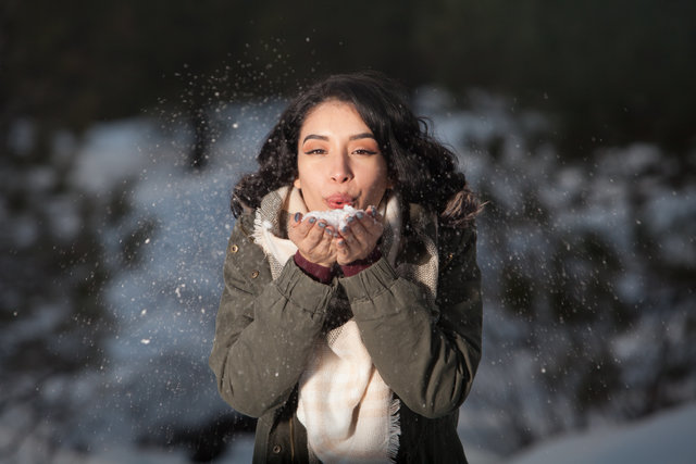 Beautiful blowing brunette cold face