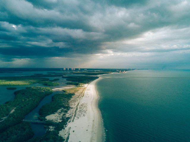 Aerial beach clouds daylight drone