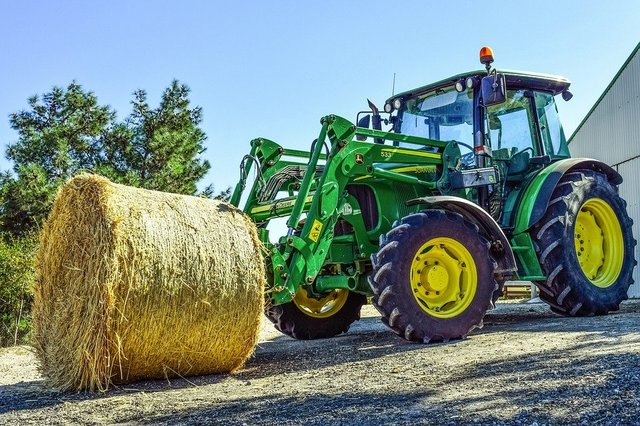 Tractor hay bale farming agriculture
