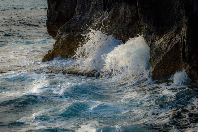 Wave crushing rocky coast rock nature