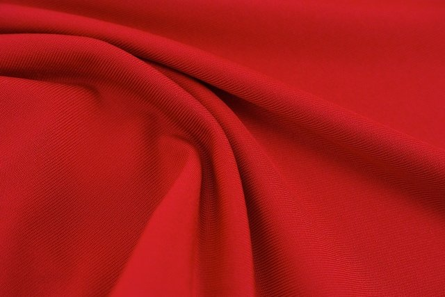 Red fabric textile texture abstract
