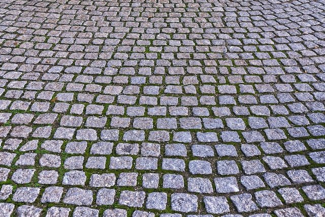 Cobblestones paving stones patch paved background