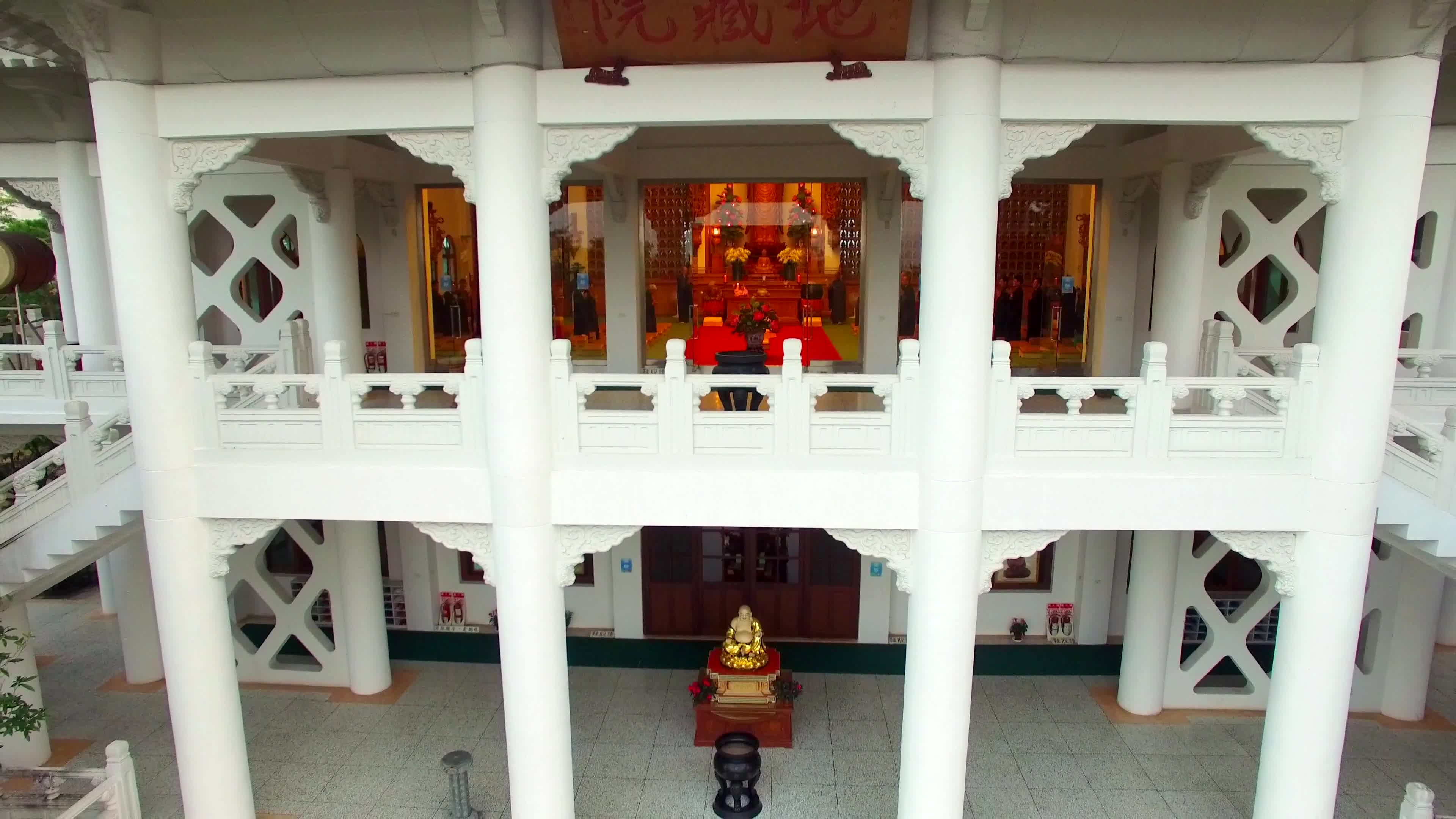 Drone shot of buddha inside the temple