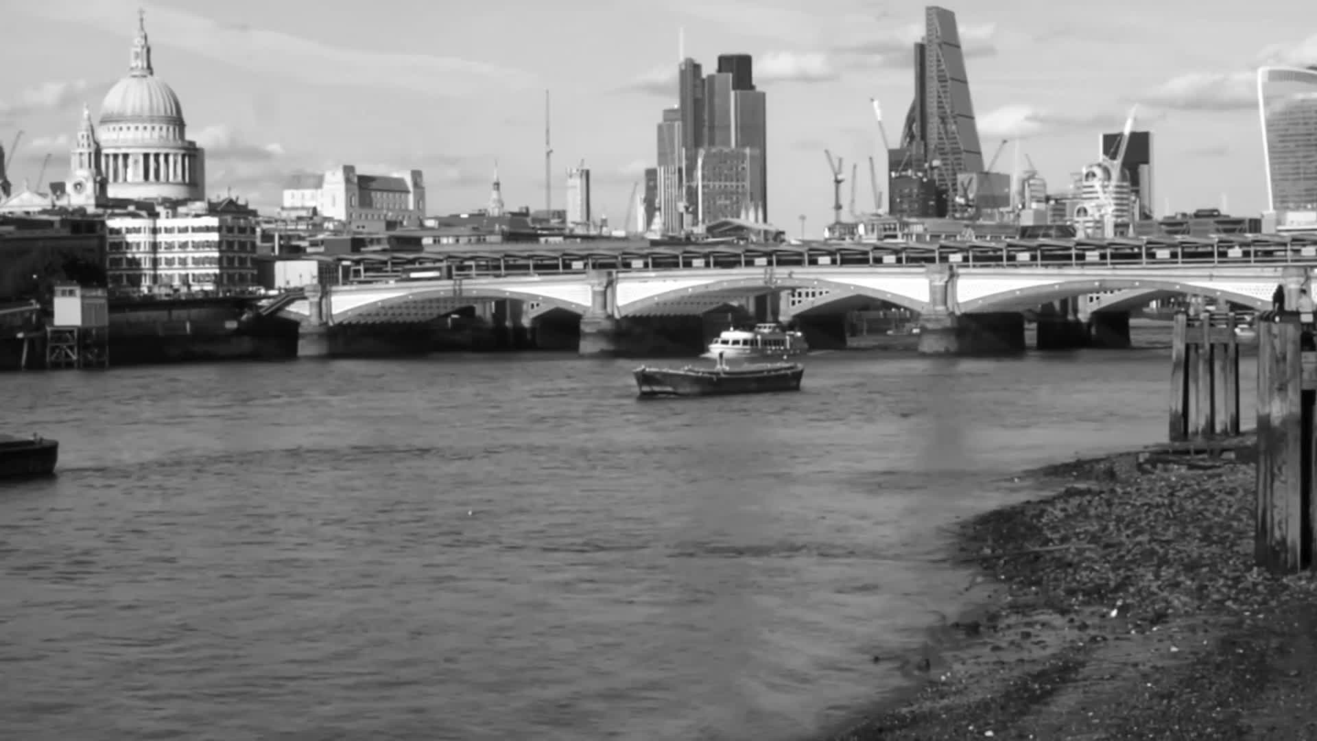 Black and white footage of boat in a river