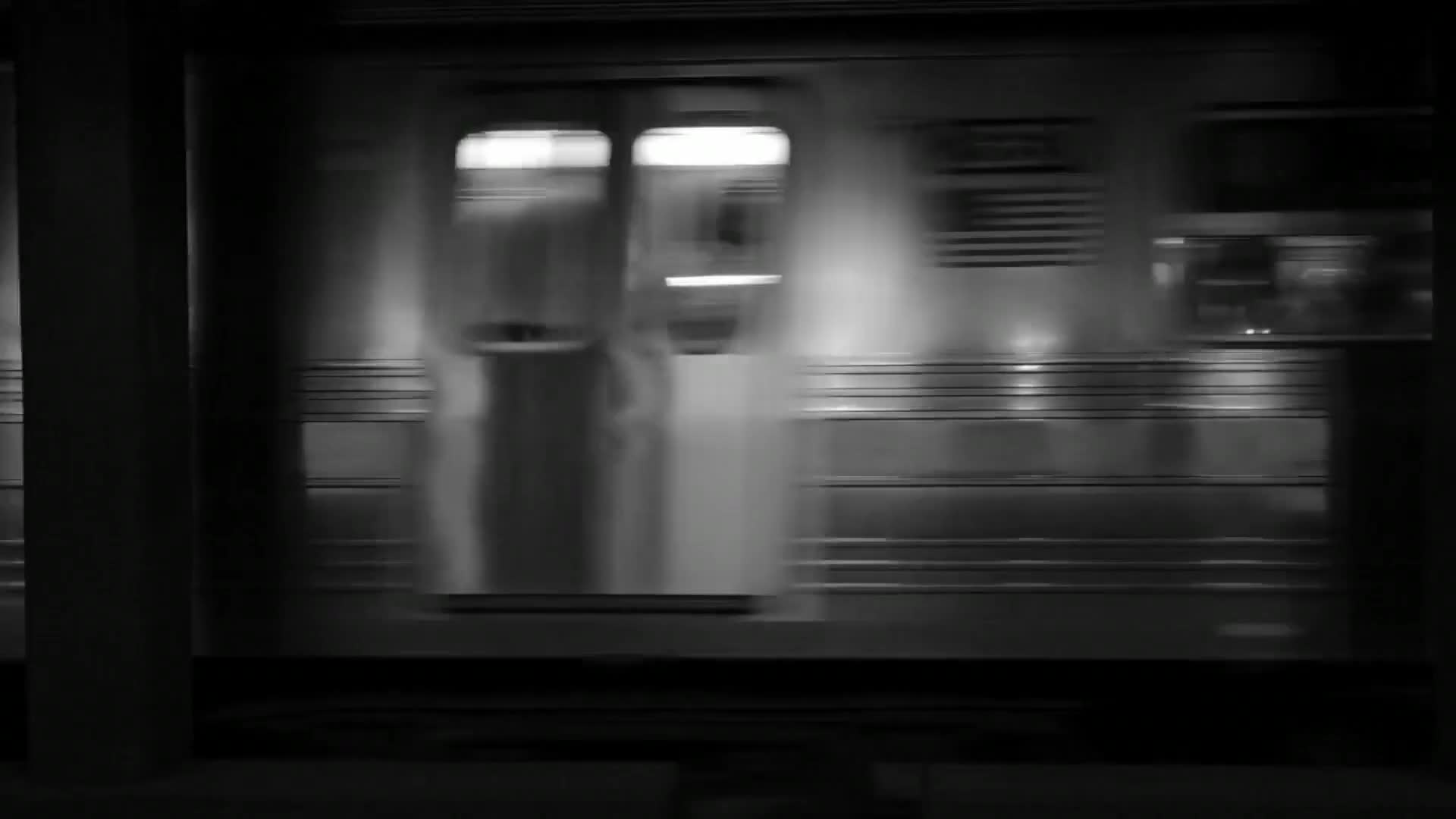 Black and white footage of train passing