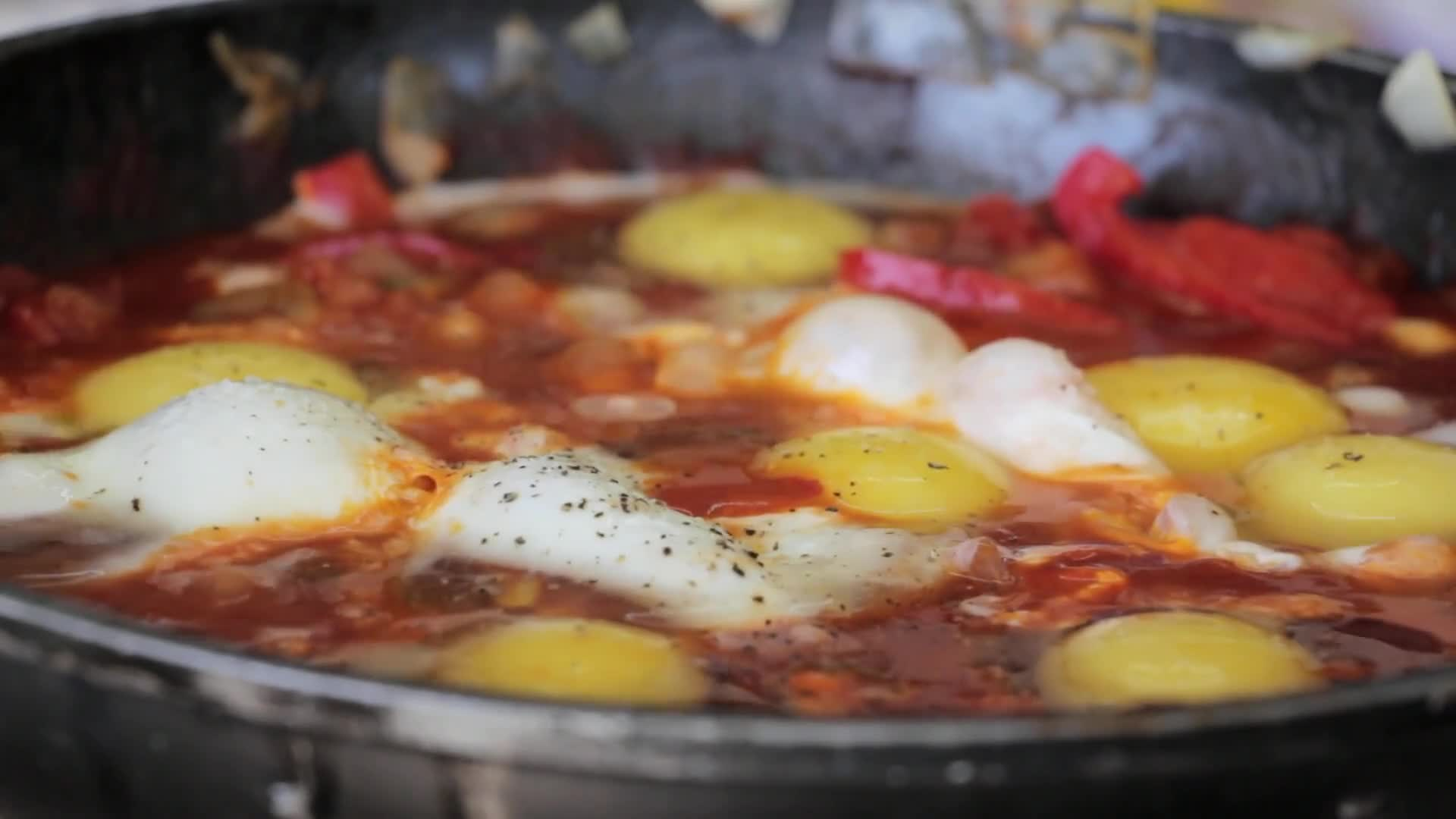 Close up video of boiling shakshuka