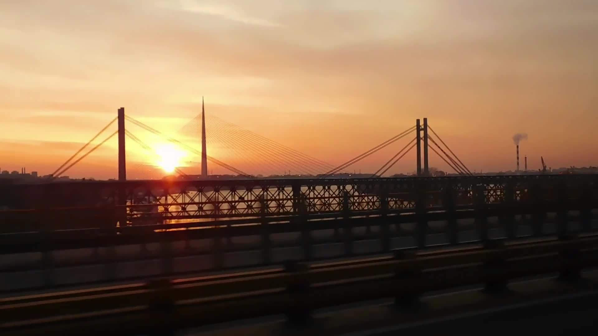 Driving over a bridge during sunset