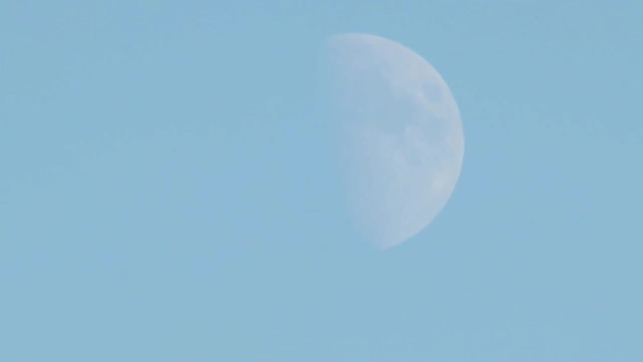 Video of moon and rocket contrails