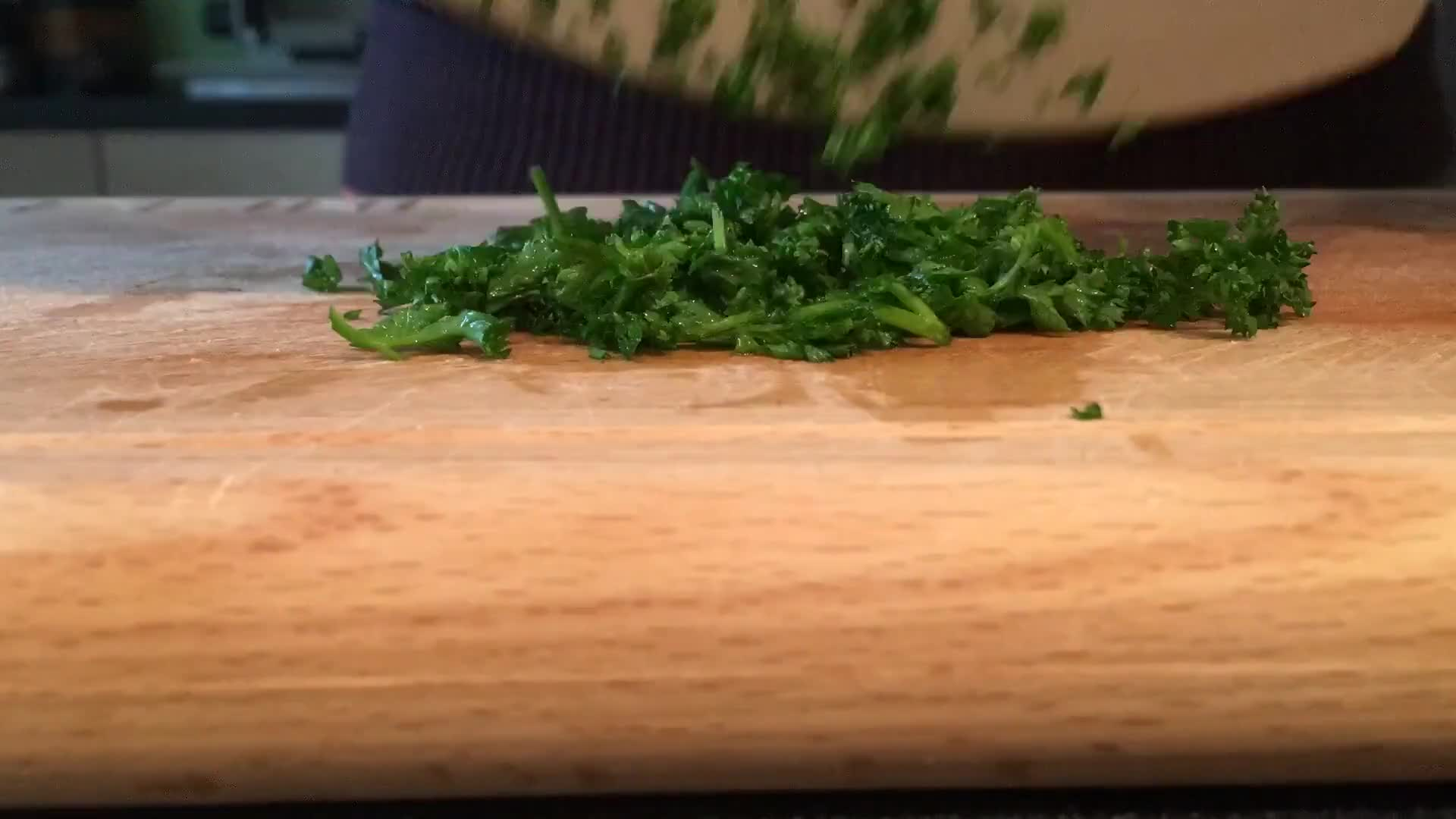 Chopping vegetable with a big knife