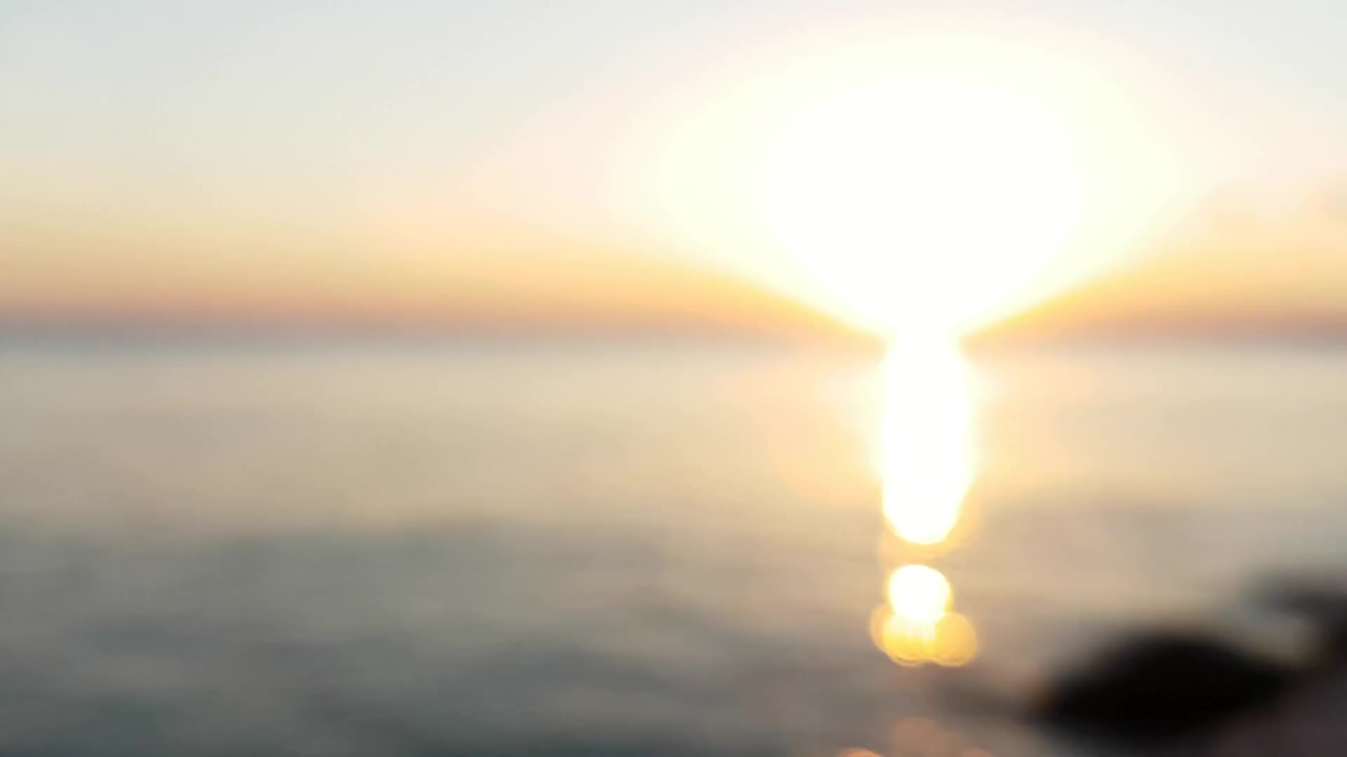 Blurred seaside sunset with water sound
