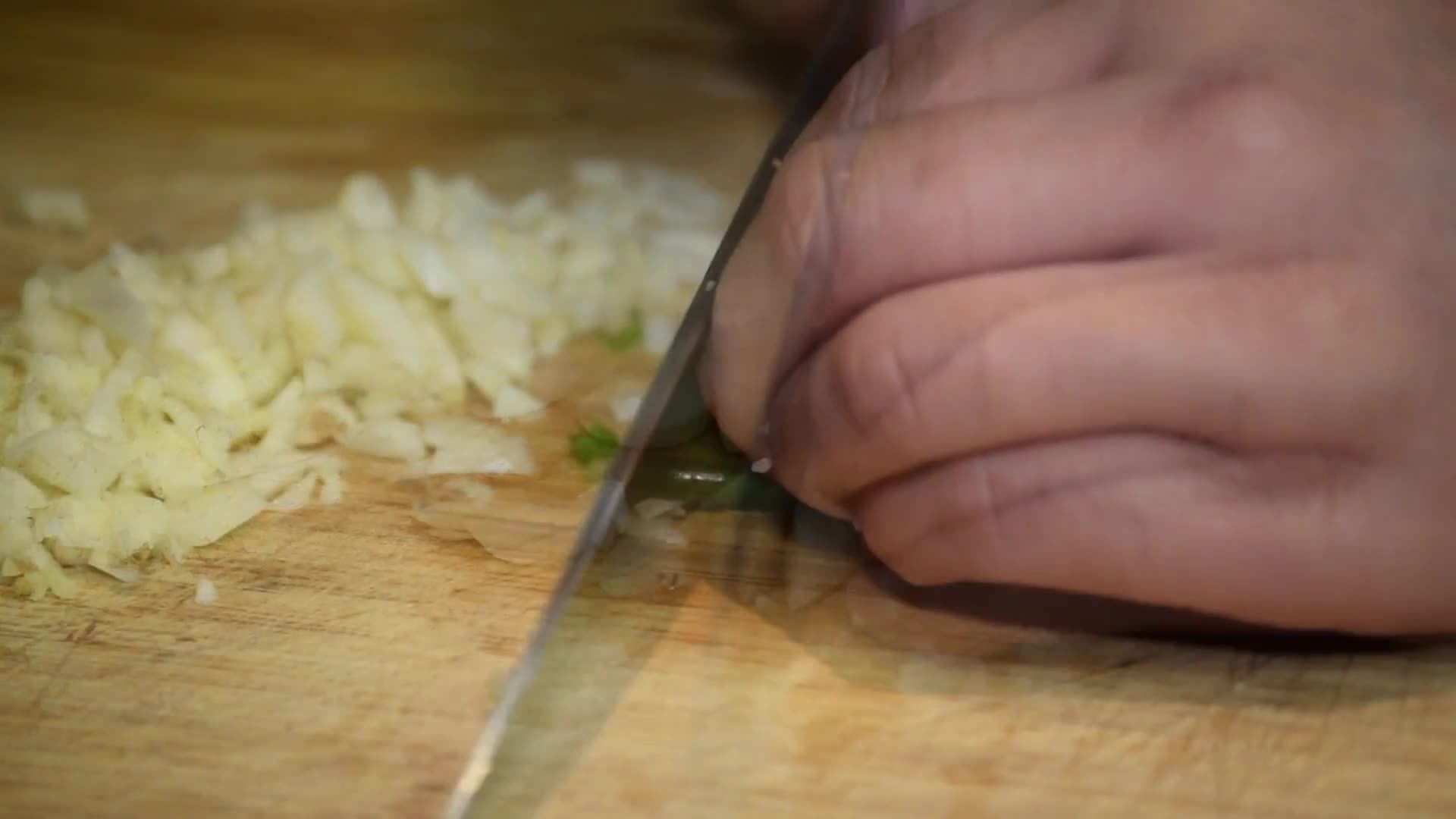 Cooking onions cutting vegetables herbs