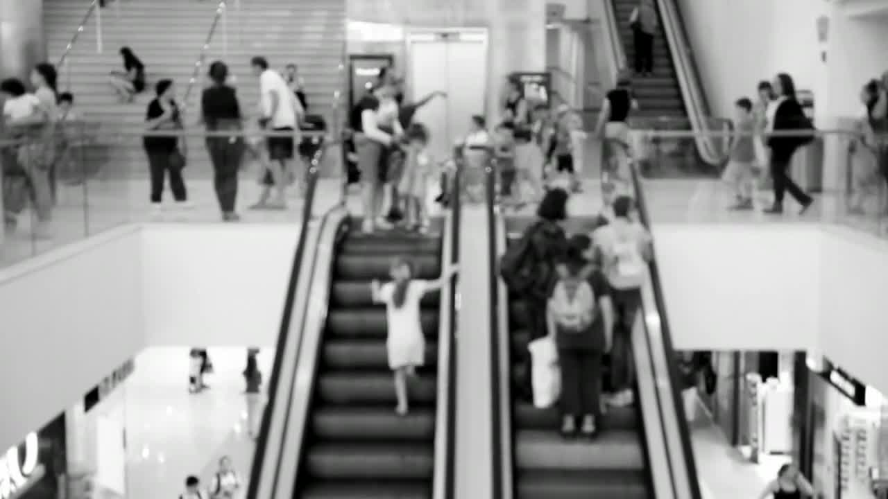 Escalators shopping center mall people shopping