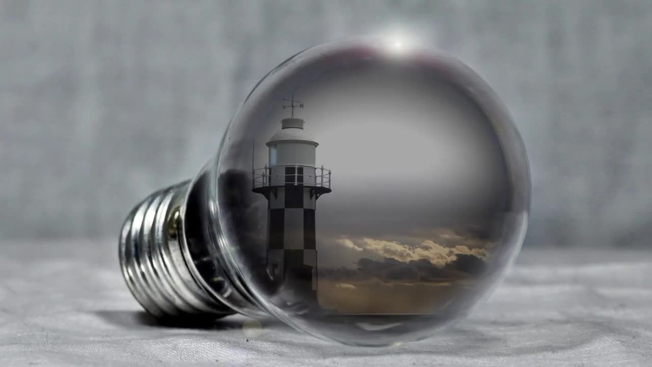 Lighthouse pear light bulb sea clouds