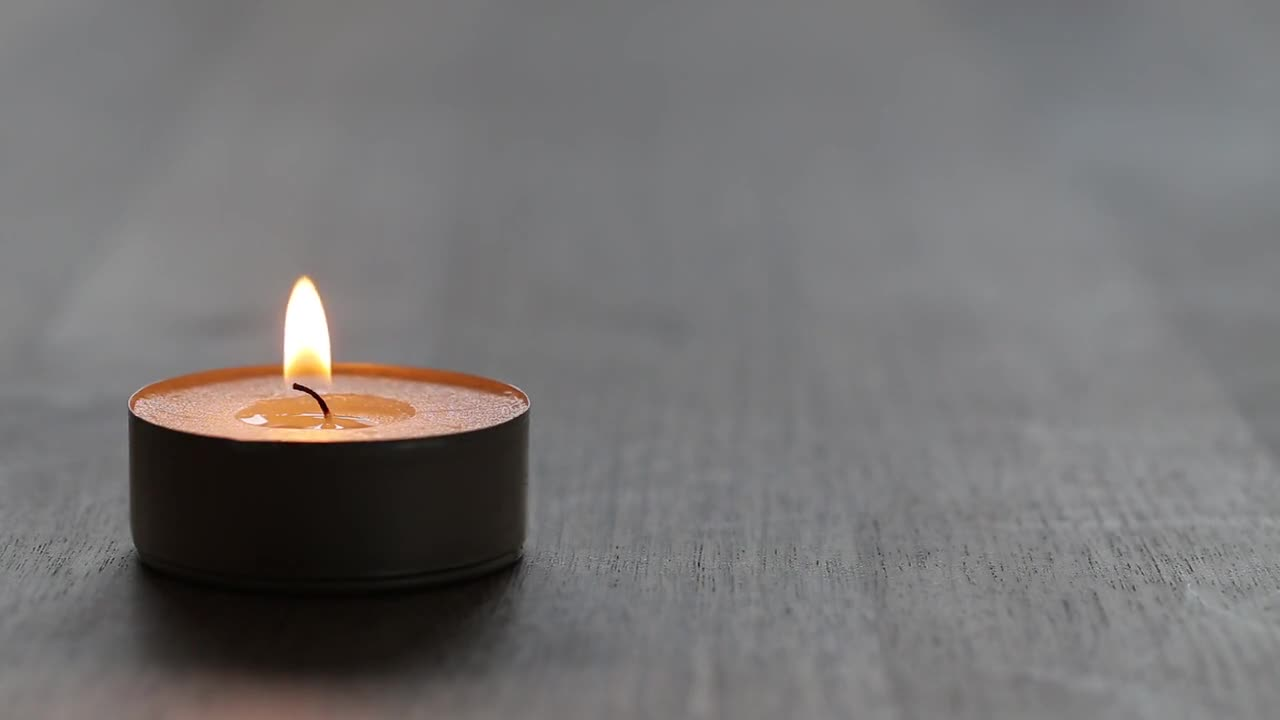 Candle macro burn tealight wooden table